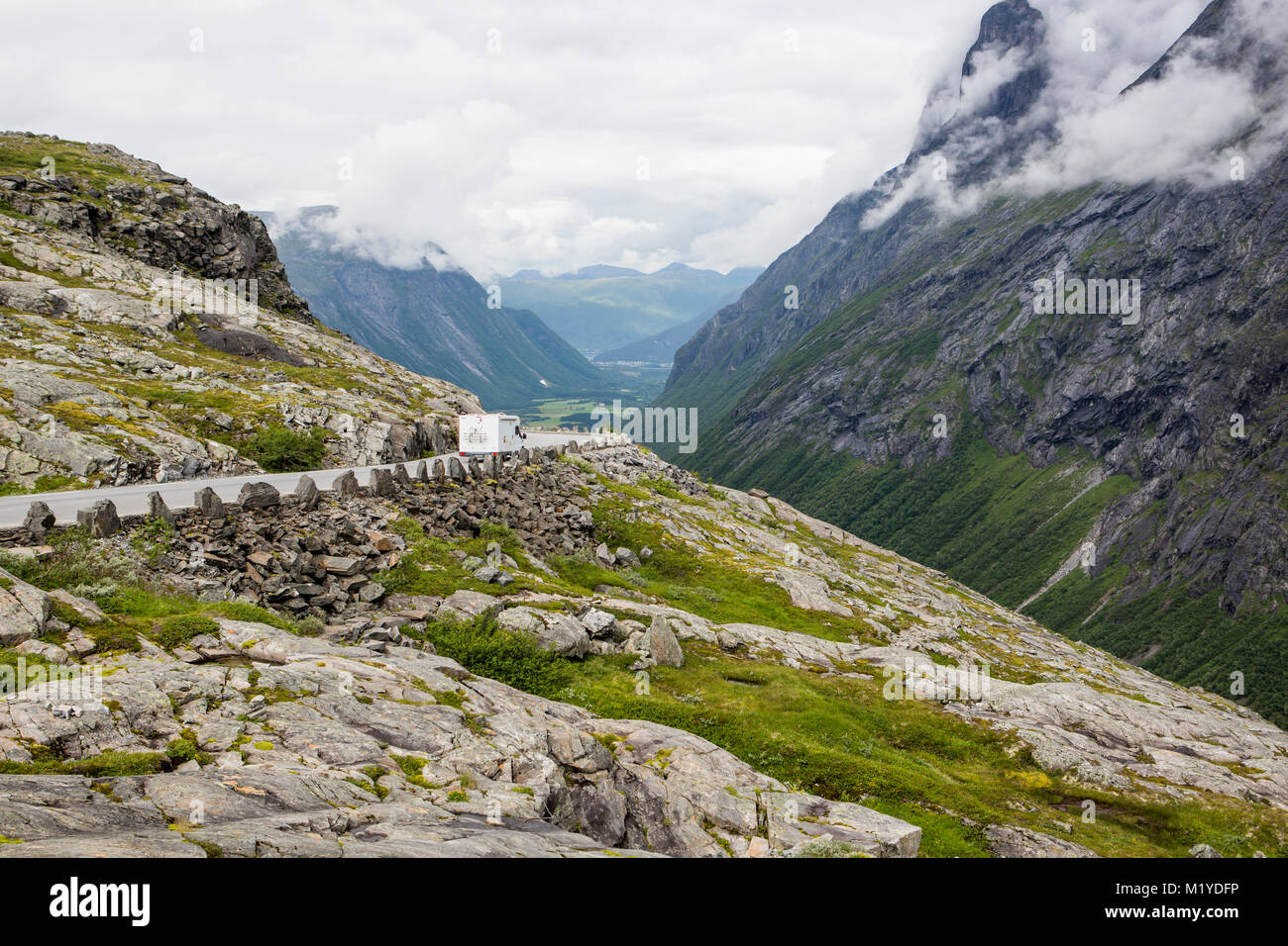 A motorhome, RV, is driving at the road Trollstigen in Norway. - Stock Image