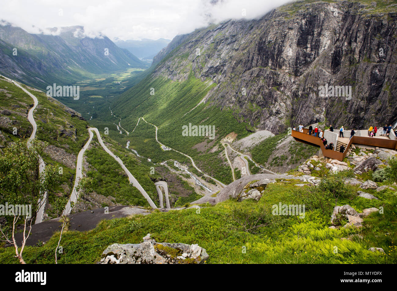 The road Trollstigen in Norway, seen from the top of the valley. - Stock Image