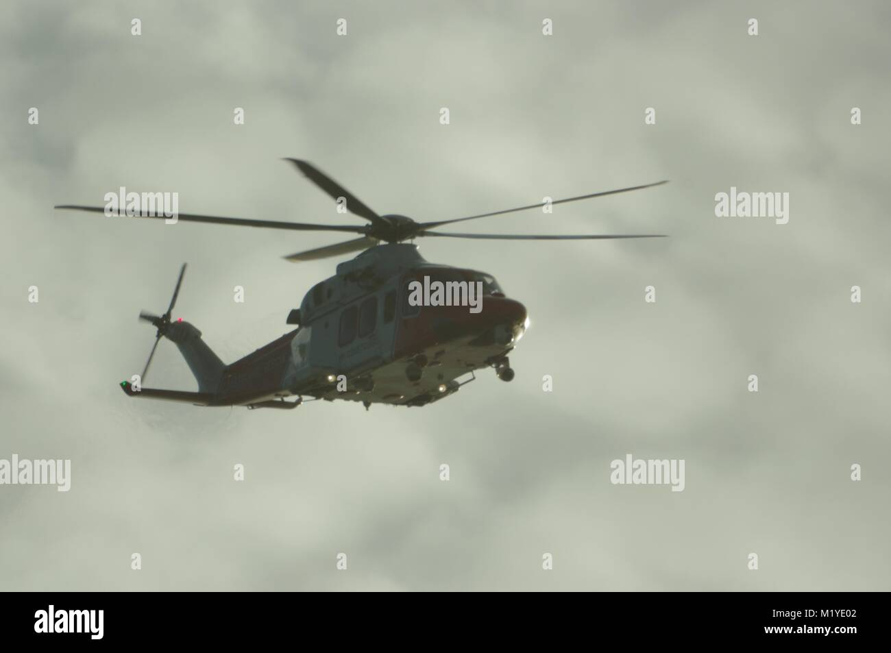 Royal Navy Helicopter Flying over the English Channel. Dawlish, South Devon, UK. - Stock Image