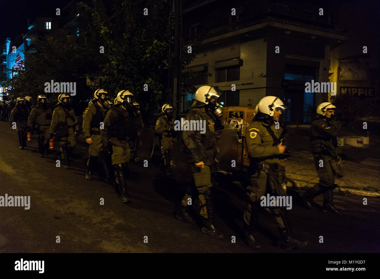 Armed men of the Unit for the Reinstatement of Order, of the Greek Police Force, marching towards the Polytechnical - Stock Image