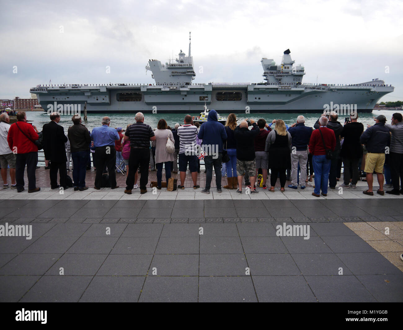 The Royal Navy aircraft Carrier HMS Queen Elizabeth enters Portsmouth harbour for the first time - Stock Image