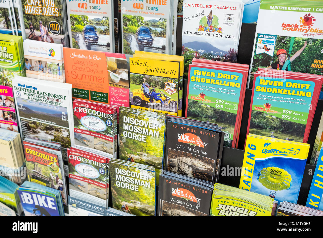 Tourism brochures and flyers promoting holiday activities around Port Douglas and Mossman gorge,Far north queensland,Australia - Stock Image
