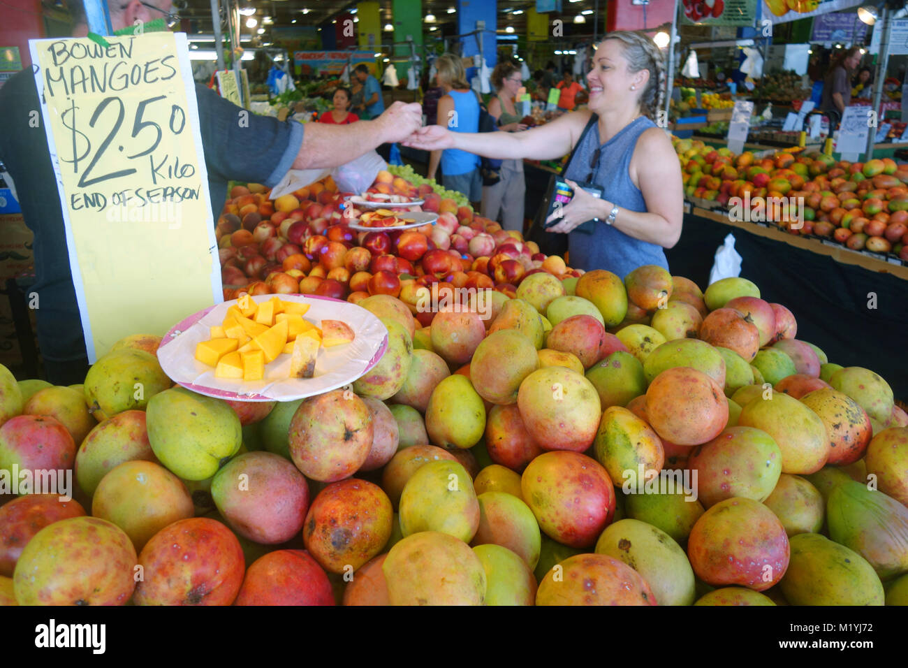 Mounds of seasonal mangoes and other fruits at Rusty's Markets, Cairns, Queensland, Australia. NO MR or PR - Stock Image
