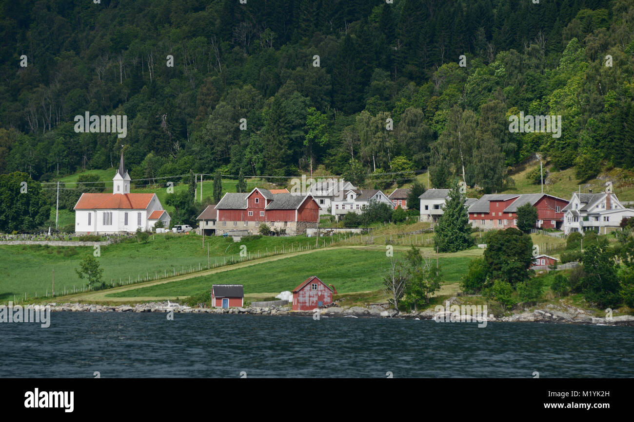 Country houses and church, Balestrand, Norway - Stock Image