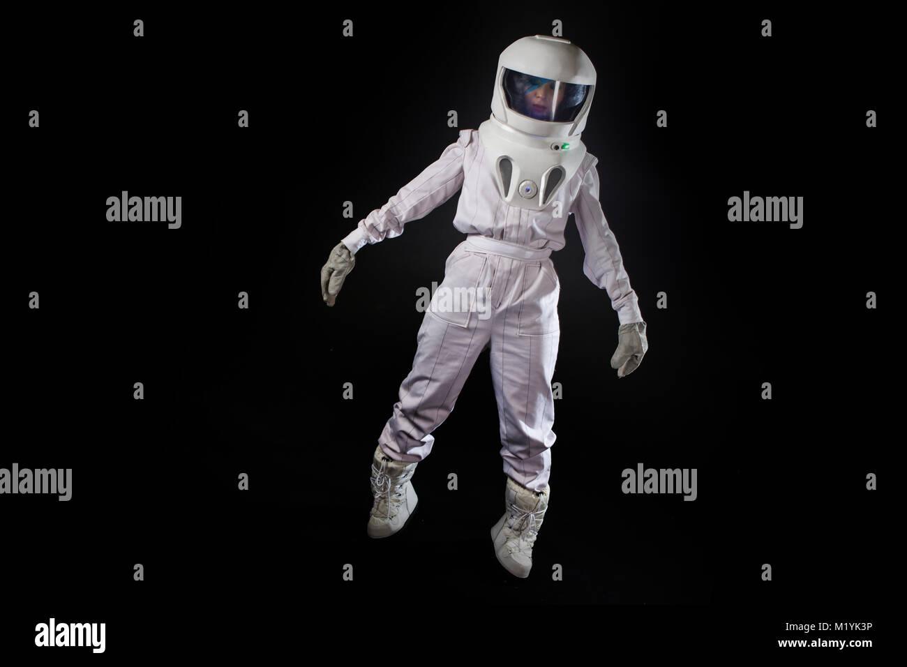 Astronaut in space, in zero gravity on black background Stock Photo
