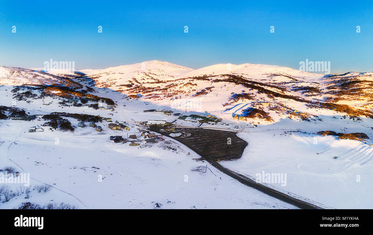 sunrise over perisher valley ski resort town in snowy mountains of
