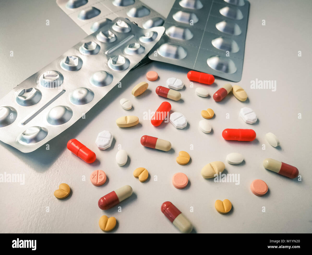 Medication white and colorful tablets arranged abstract on white color background. capsule pills for design. Health, Stock Photo