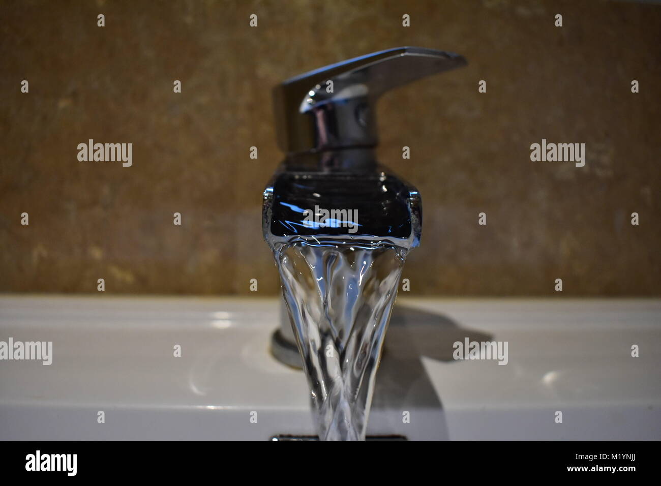Running chrome fountain tap - Stock Image