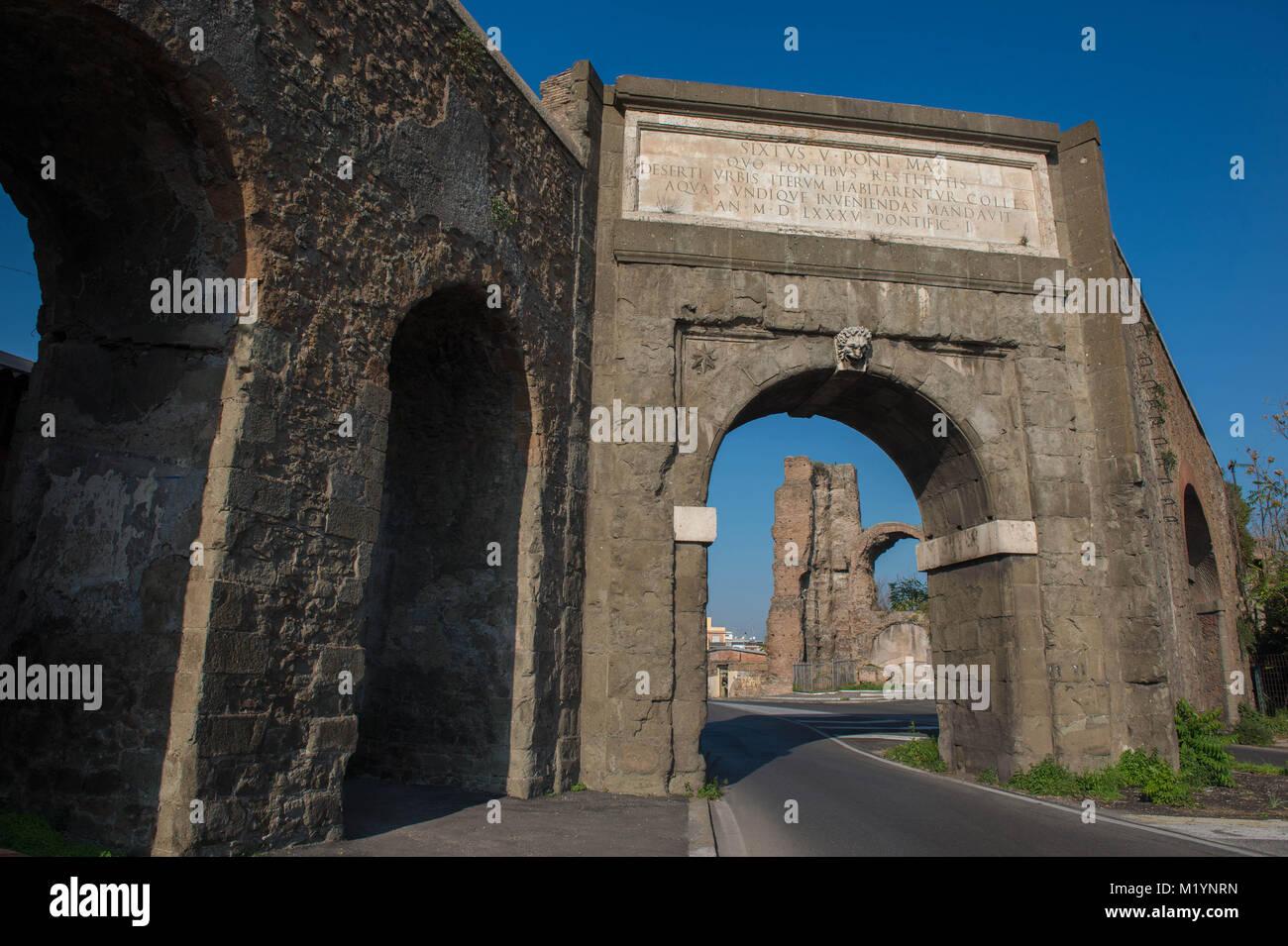Rome, Italy. Porta Furba, where the aqueduct Acqua Felice crosses via Tuscolana. - Stock Image
