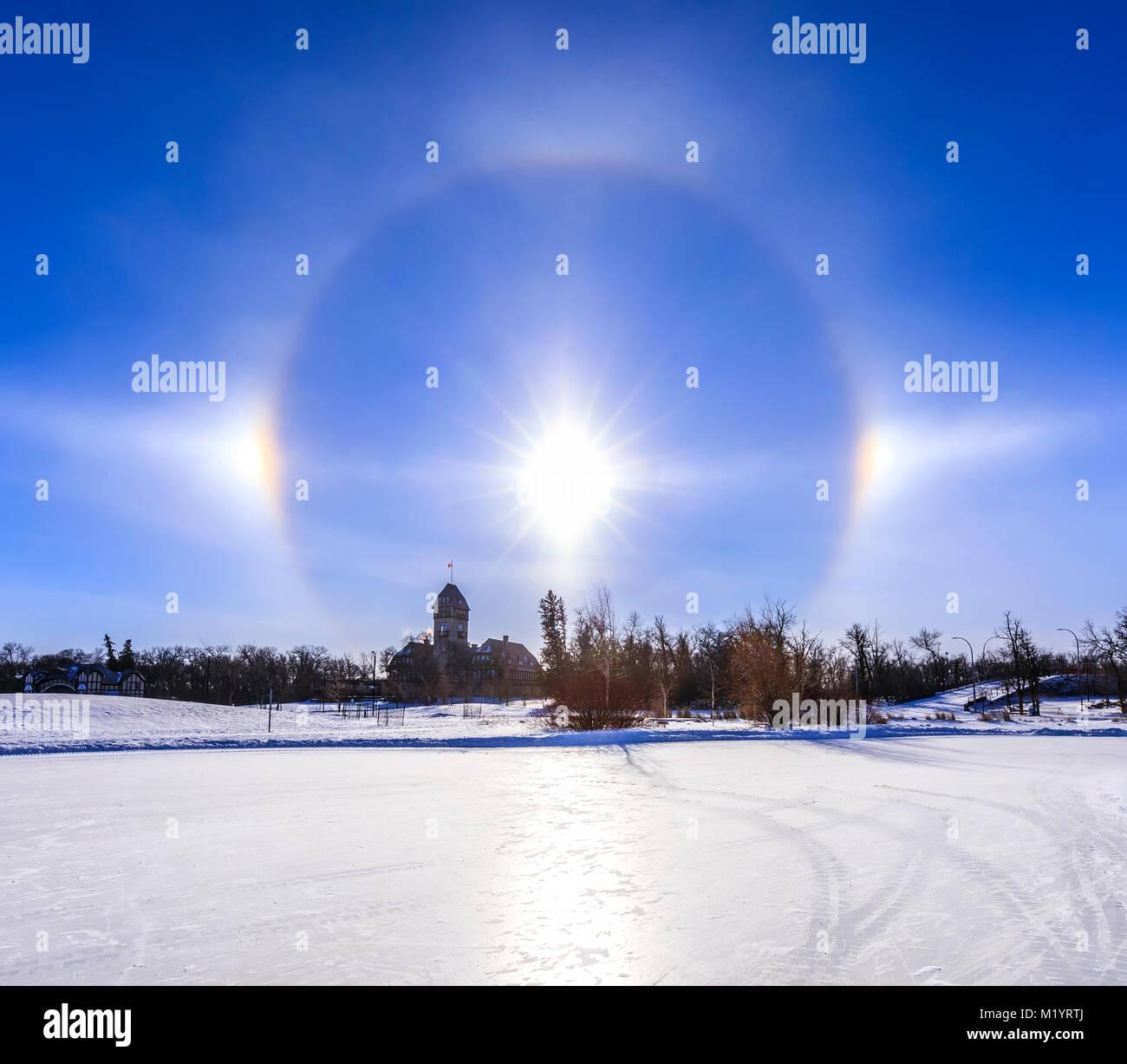 Sun dogs with halo over Assiniboine Park, Winnipeg, Manitoba, Canada. - Stock Image