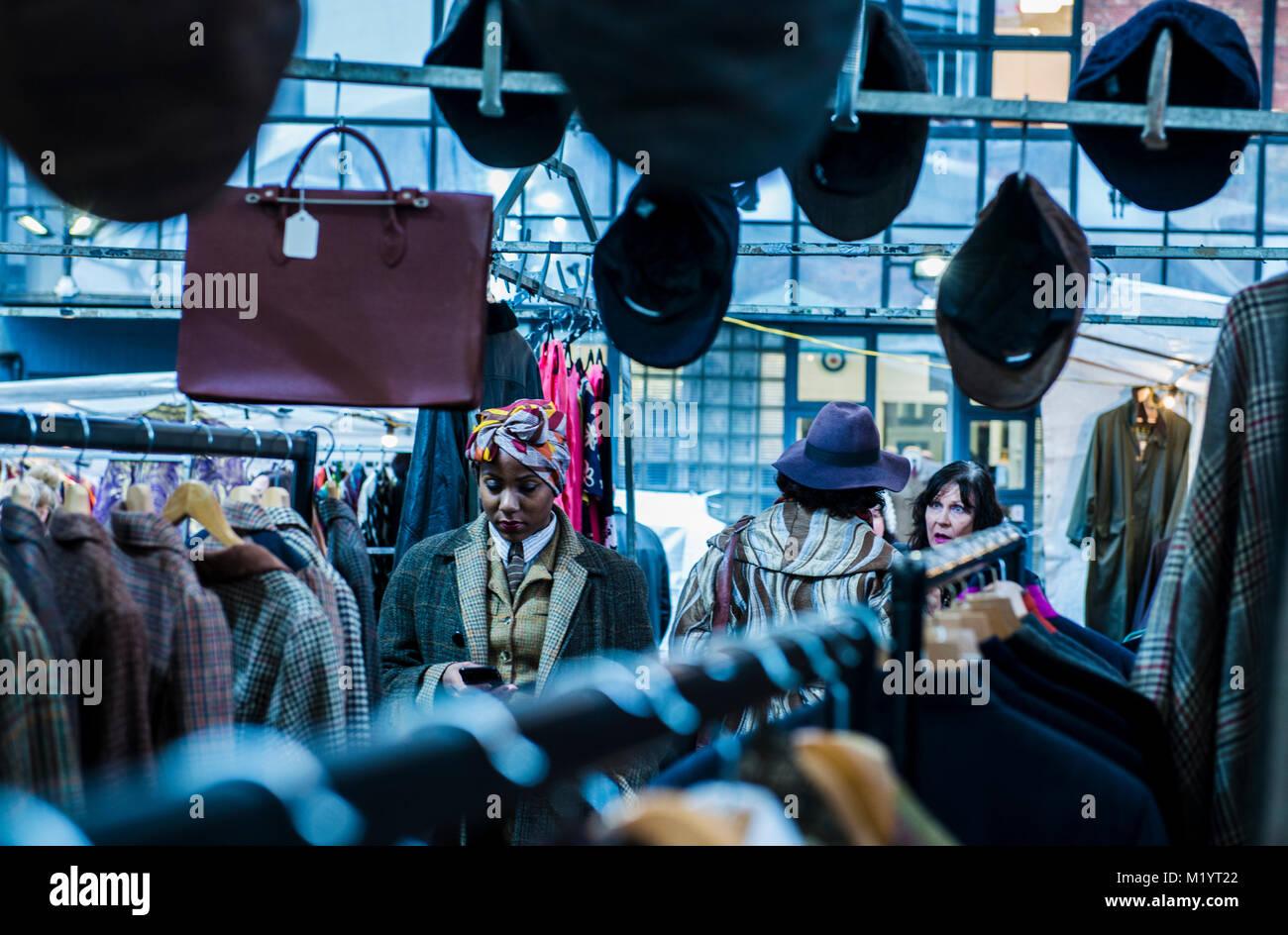 People in clothes market, Portobello, London, England - Stock Image