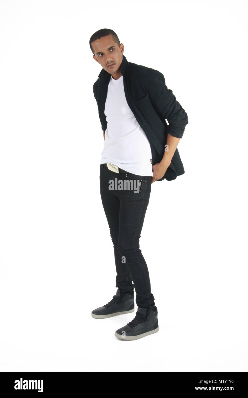 67c56d151a0 A mixed race male in black and white casual formal outfit staring at a  subject