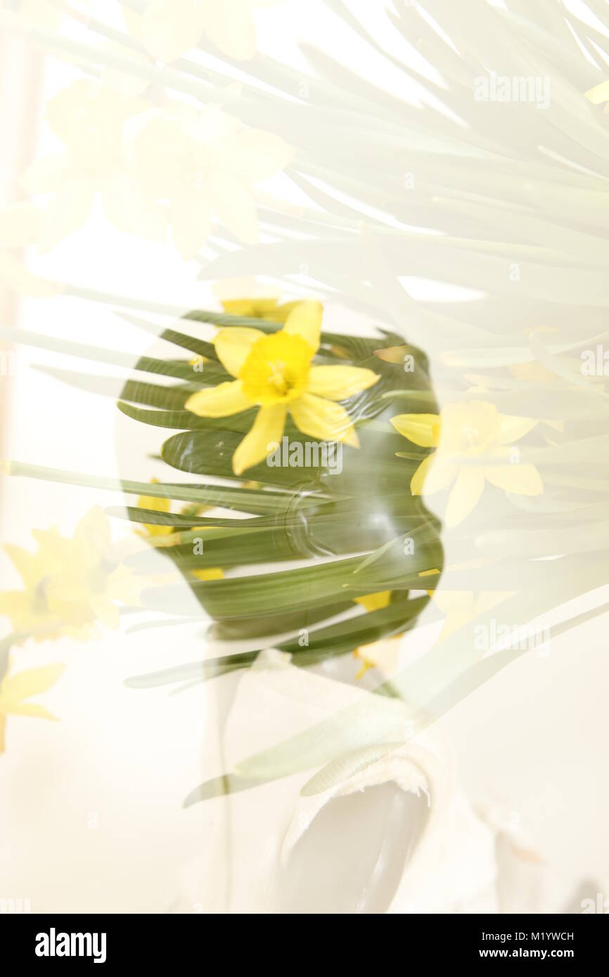 Double exposure dolls head with flower - Stock Image