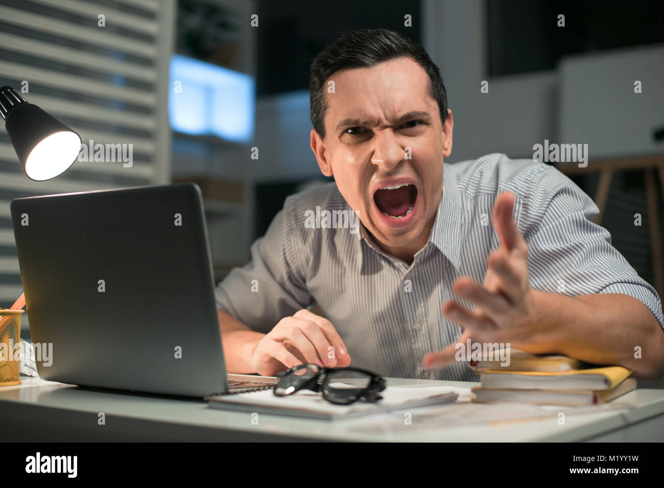 Pleasant male employee losing control - Stock Image