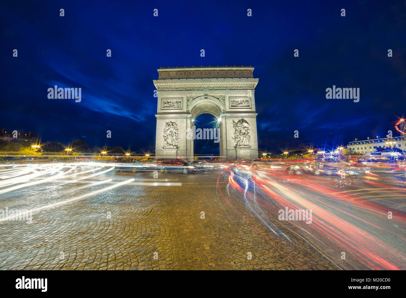 View of arc de triomphe during the twilight and long exposure image with light trails - Stock Image