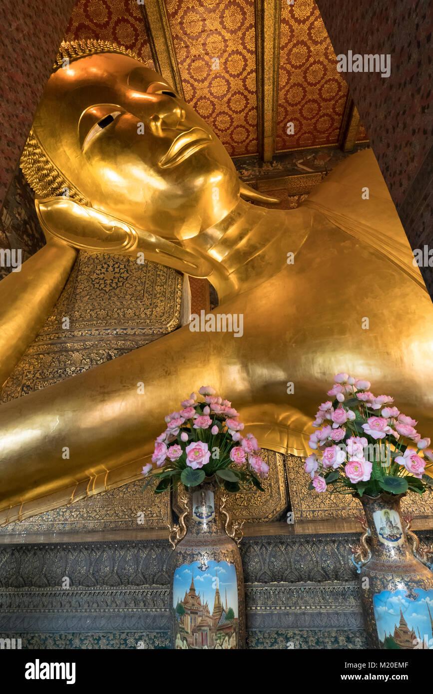 the reclining Buddha Wat Pho temple in Bangkok, Thailand - Stock Image