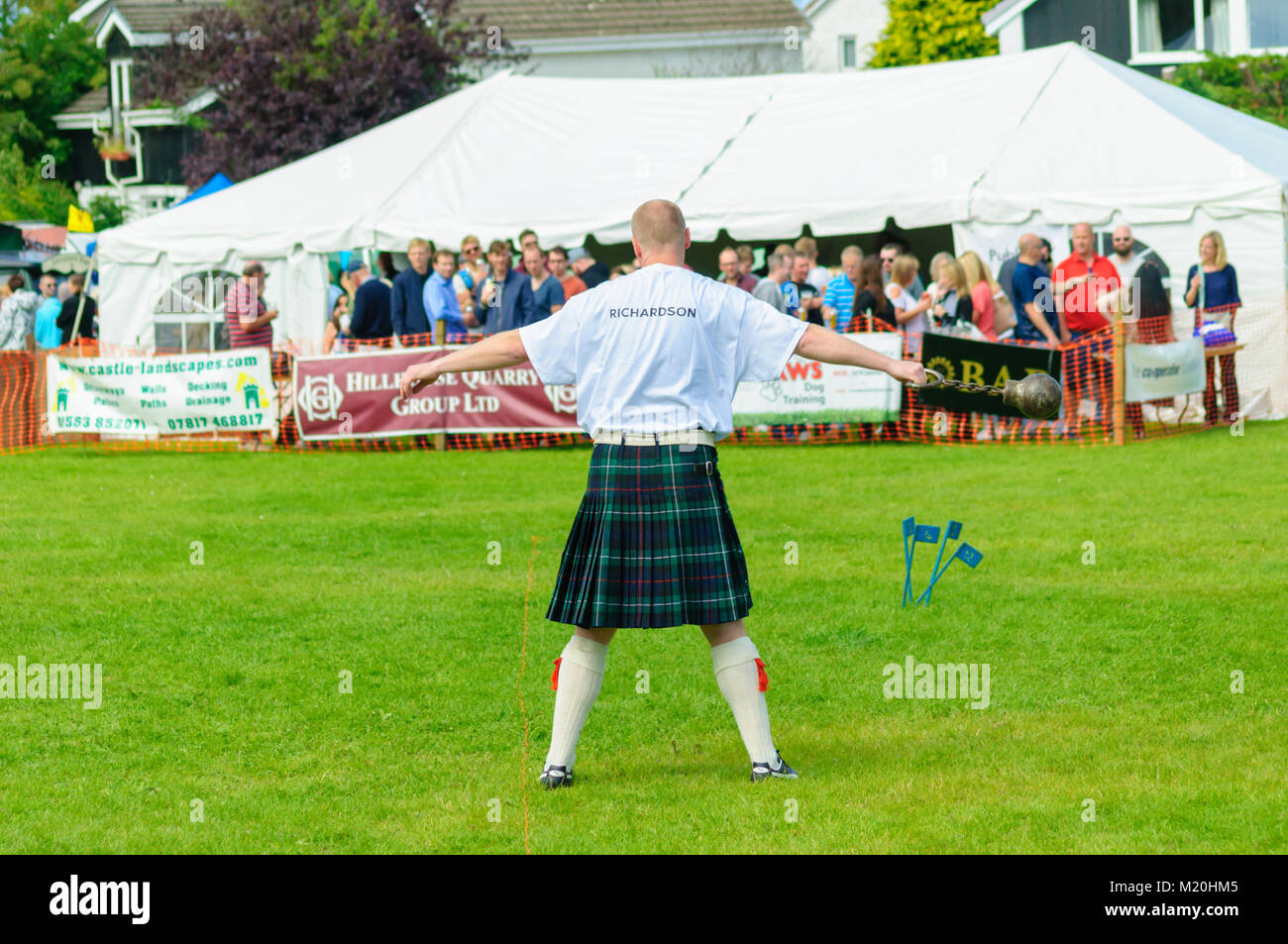 Male prepares to compete in the weight throw competition at the Dundonald Highland Games, Ayrshire, which celebrates - Stock Image