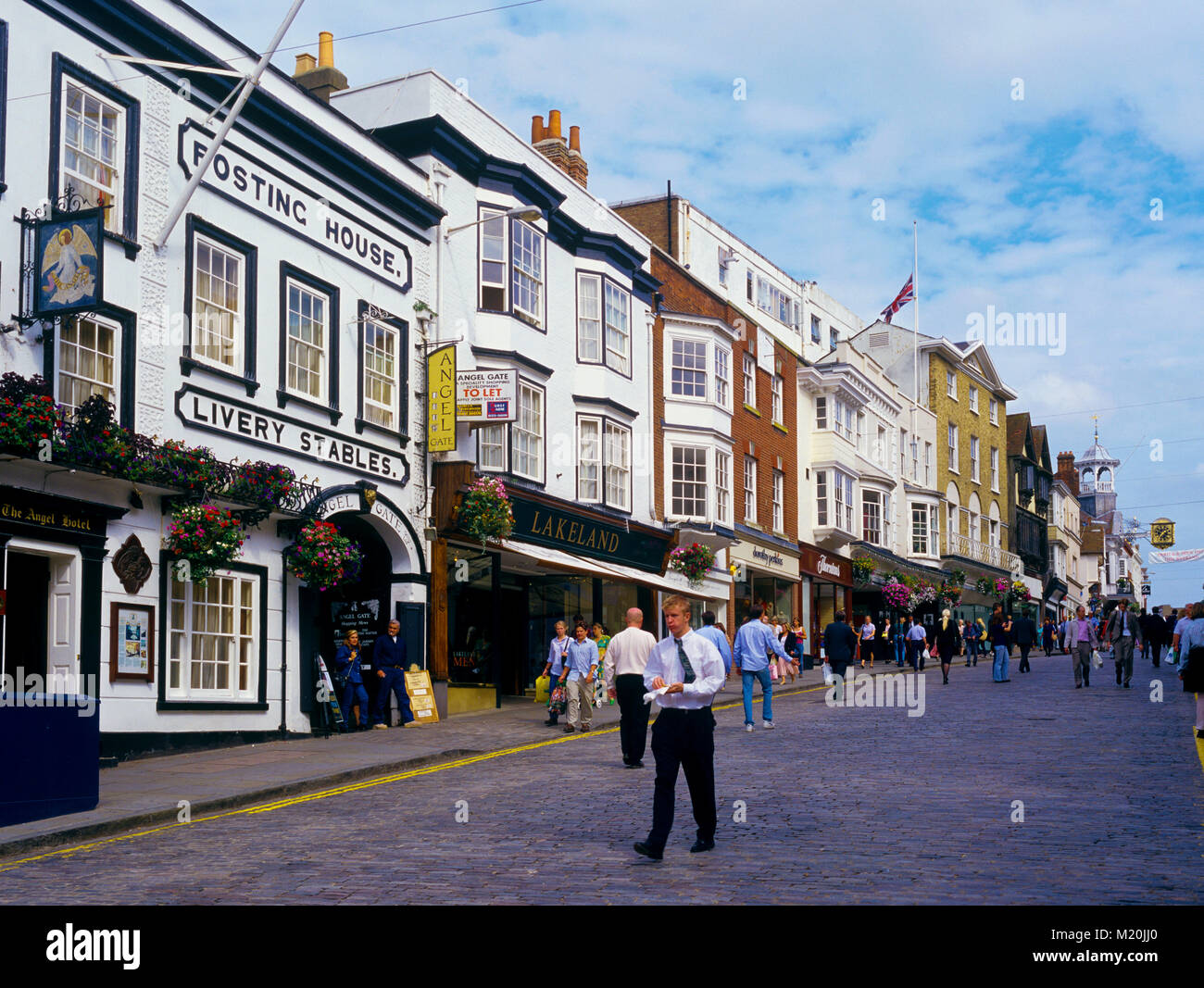 Guildford High Street Surrey England UKon a busy lunchtime with shoppers out in shirt sleeves - Stock Image