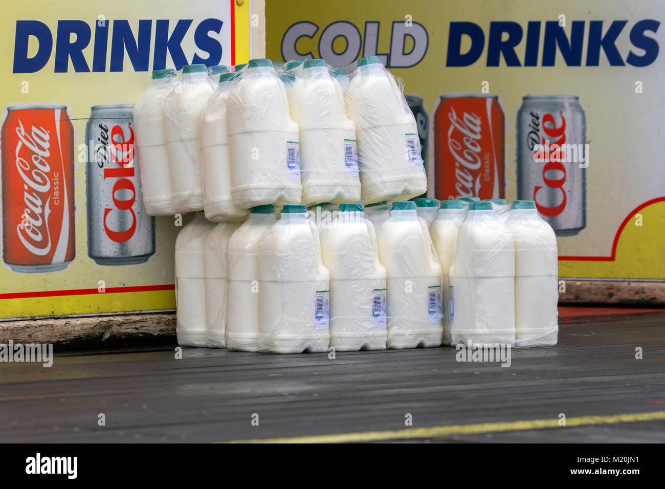 Plastic Bottles of cold Milk, supplies to seaside cafe in Southport, UK Stock Photo