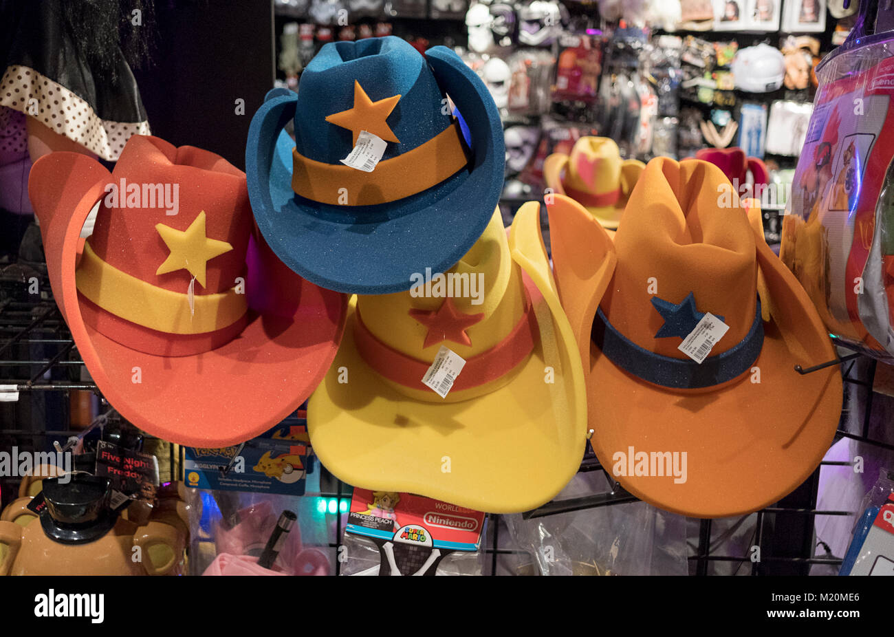 26cc74c4fc839 Oversized colorful foam cowboy hats for sale at the Halloween Adventure  costume store on Broadway in