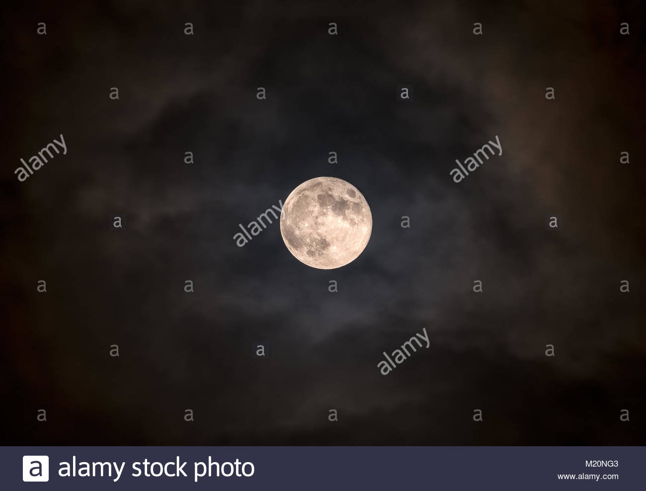 Super moon Blue moon against clouds in sky Stock Photo