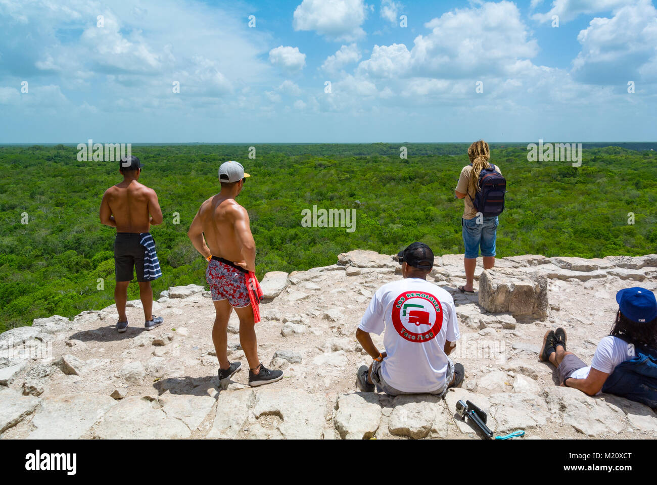 Tourists on the top of pyramid Coba Mxico - Stock Image