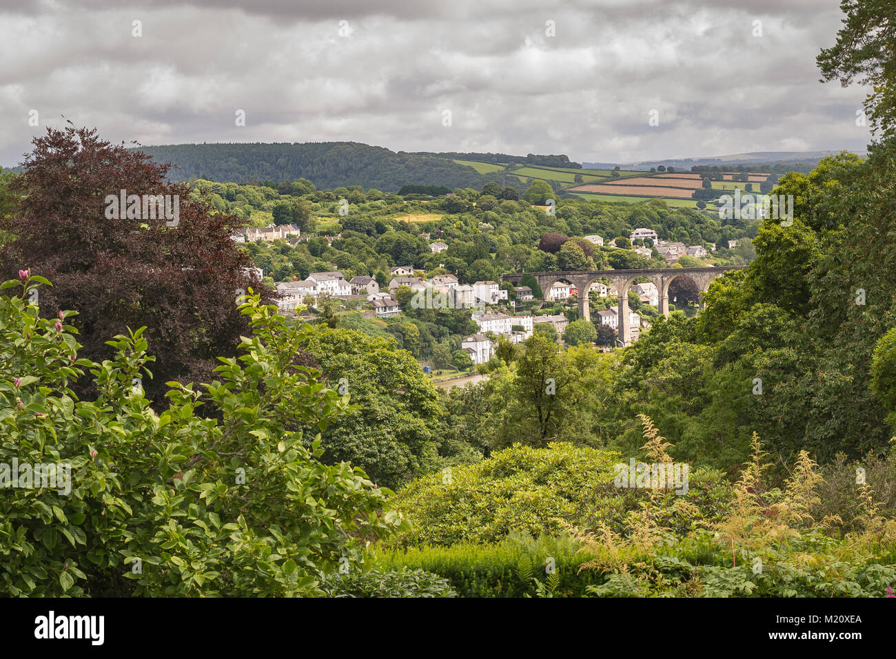 English village with viaduct. - Stock Image