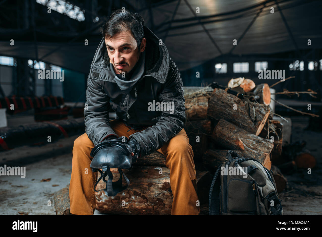 Stalker concept, man with gas mask in abandoned building. Post apocalyptic lifestyle, doomsday, horror of nuclear - Stock Image