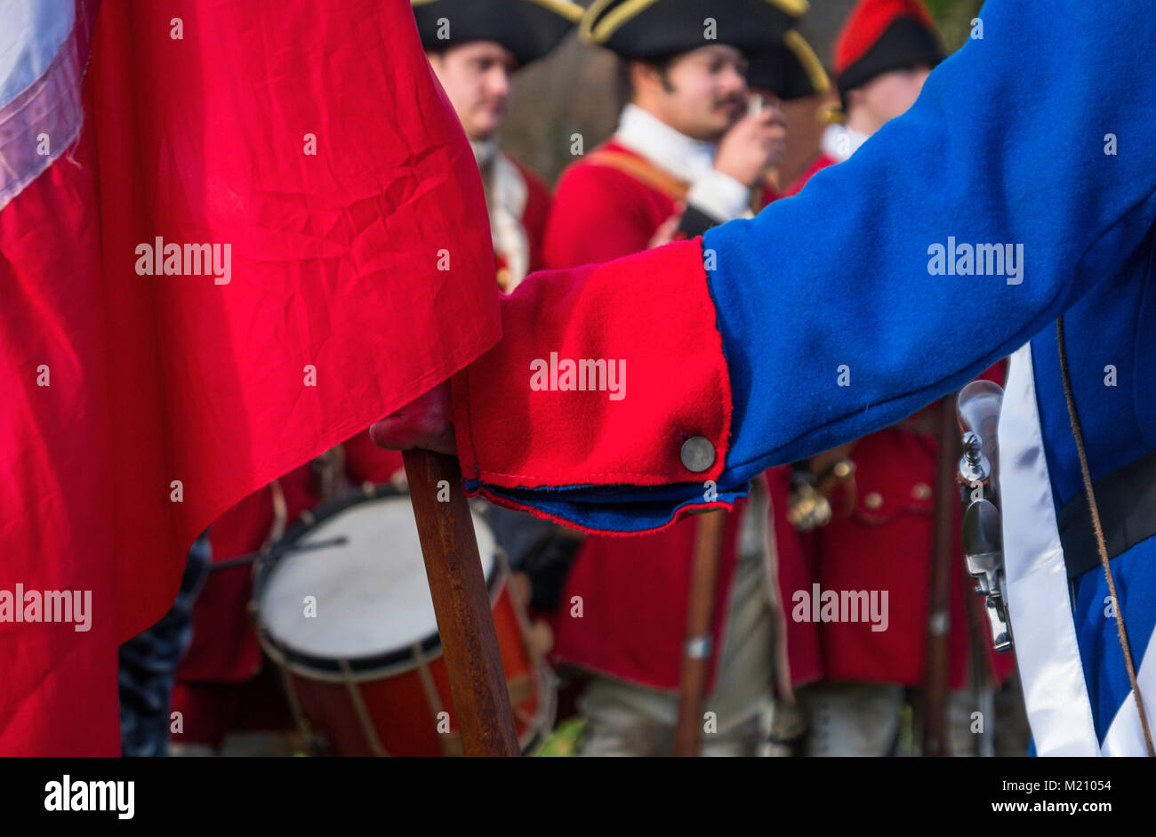 French Soliers with their colours at a re-enactment of the Jacoite rising of 1745 in support of Bonnie Prince Charlie. Stock Photo