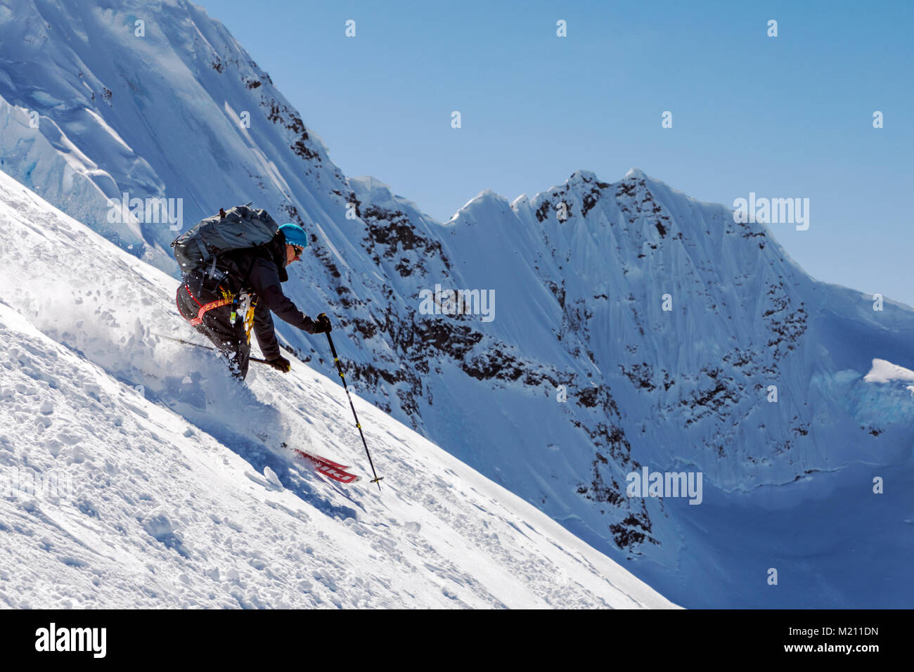 Alpine ski mountaineer skiing downhill in Antarctica; Nansen Island Stock Photo