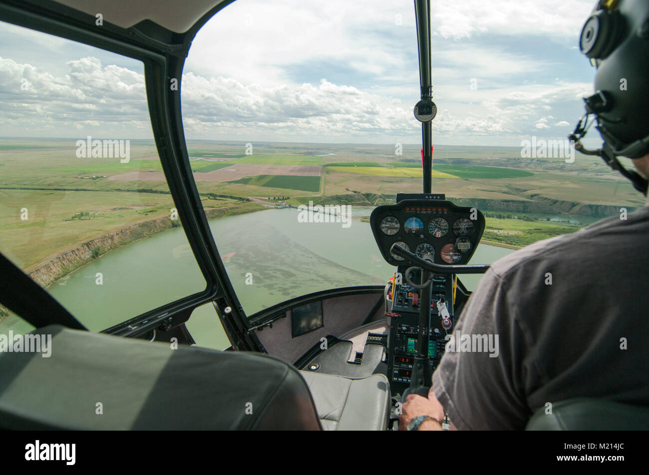 Bassano Dam, Alberta, Canada.  Aerial view looking south from behind the cockpit of a helicopter in the summer. - Stock Image