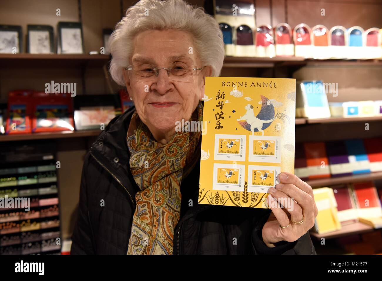 Paris. 3rd Feb, 2018. A philatelist presents a souvenir sheet of stamps designed for the lunar year of dog in Paris, Stock Photo