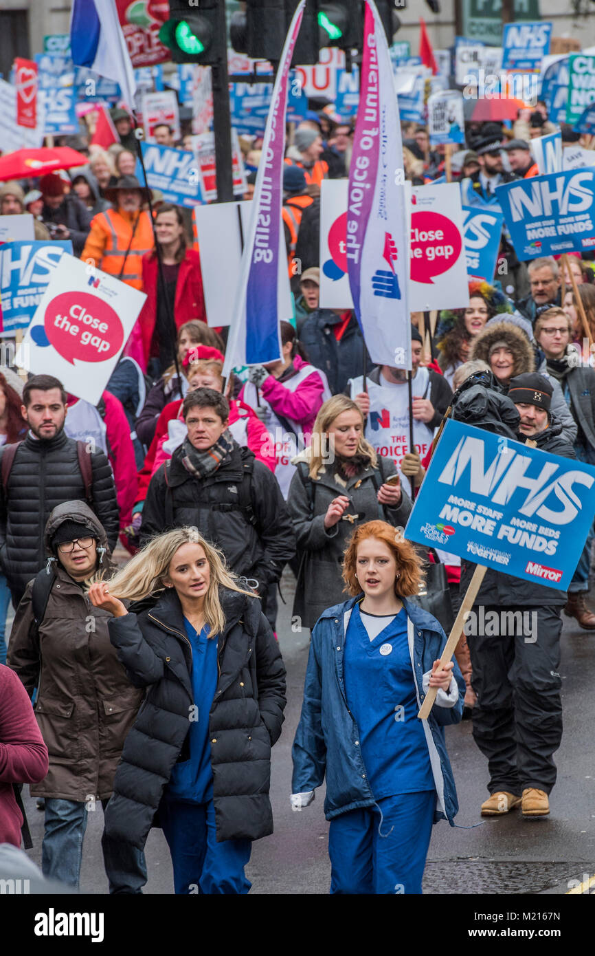 London, UK, 3 Feb 2018. Nurses in scrubs at the front of the march - NHS In Crisis - Fix It Now March and Demonstration - Stock Image