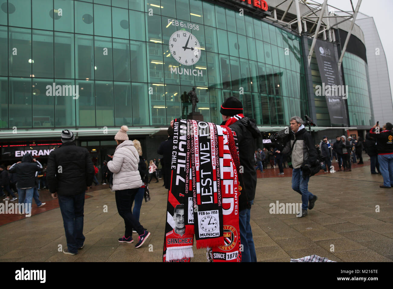 Manchester, UK, 3 Feb 2018. A scarf seller on the 60th anniversary of the Munich Air Disaster. On the 6th February - Stock Image