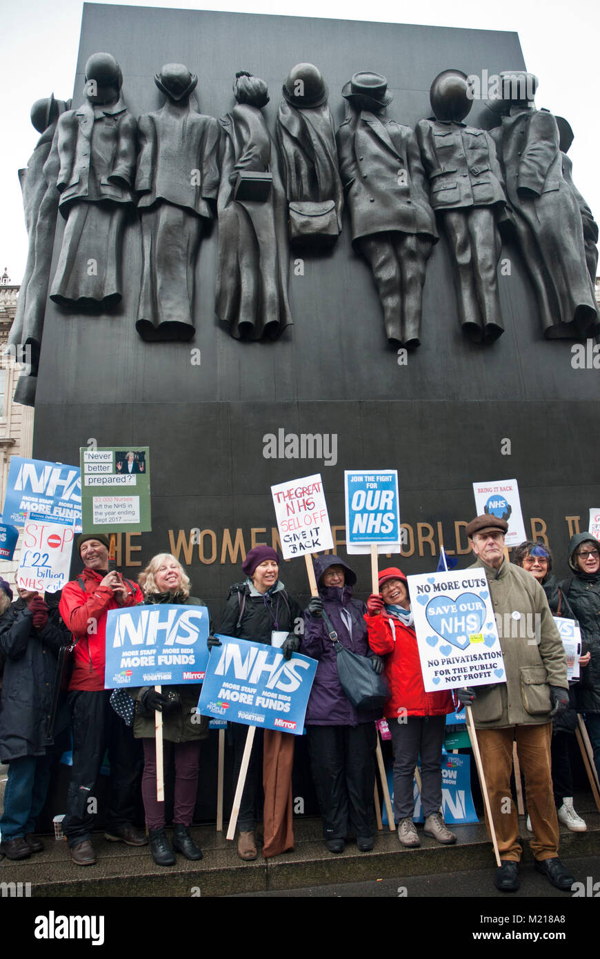 London, UK. 3rd February,2018. Smiling protesters with placards with 'Our NHS', 'The Great NHS sell - Stock Image