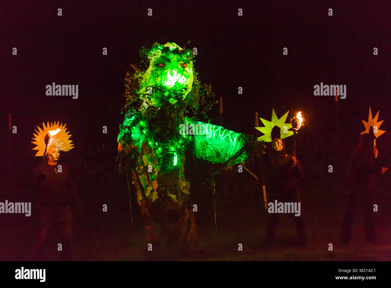 Marsden, UK. 03rd February, 2018. The Green Man is led away after defeating Jack Frost at the  Imbolc Fire Festival. - Stock Image