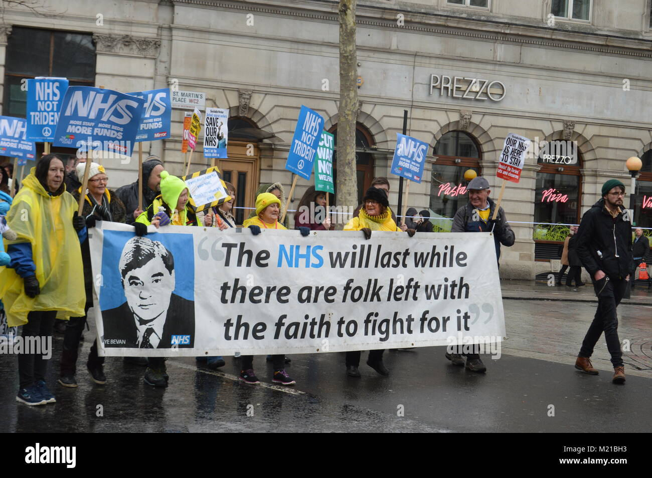 LONDON - 3 FEBRUARY 2018: Thousands march to Downing Street to demonstrate against a funding crisis in the NHS (National - Stock Image