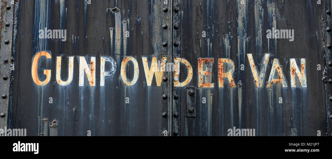 The name on the side of a railway gunpowder van in need of restoration at the Didcot Railway Centre. - Stock Image