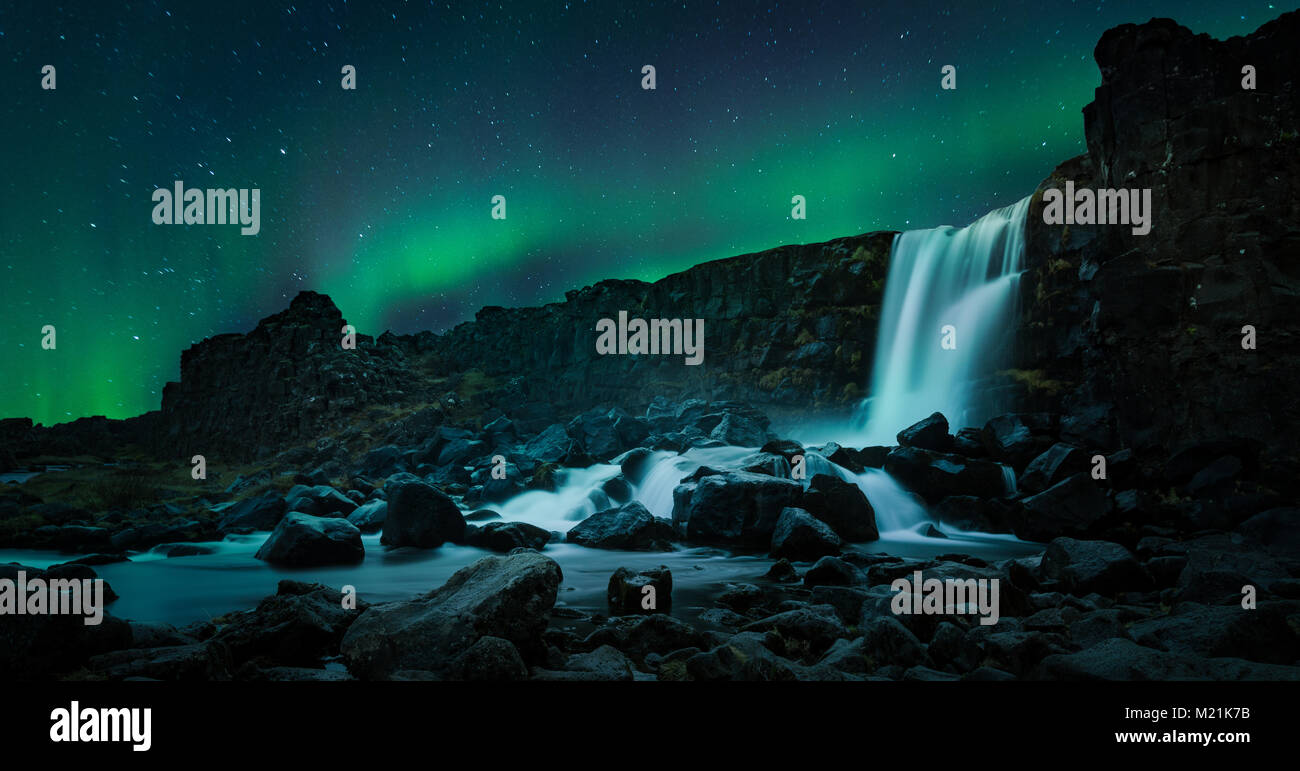Northern Lights Iceland Lady Aurora borealis waterfall Stock Photo