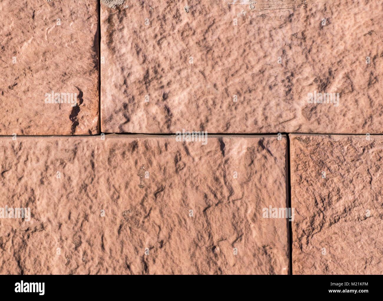 orange sandstone tiled wall. texture, background. - Stock Image