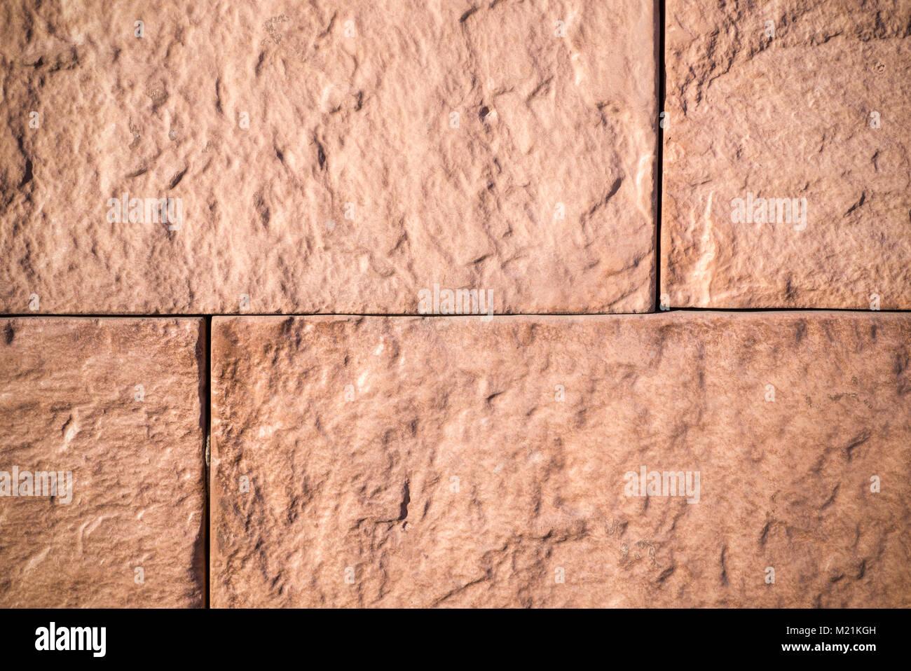 orange sandstone tiled wall. vignette, texture, background. - Stock Image