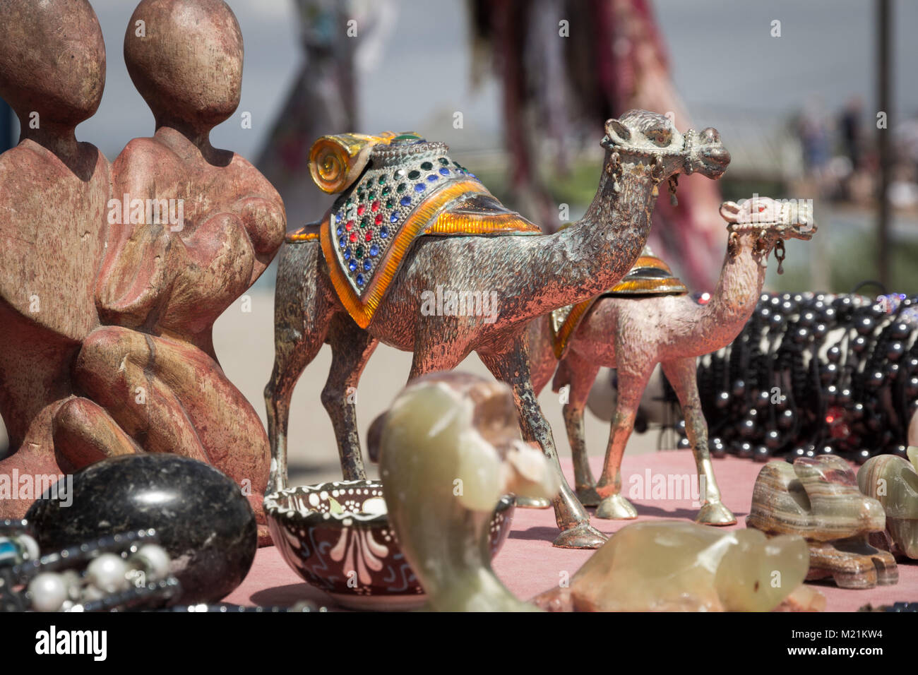 Souvenir Sales Booth with Camels and Figures - Stock Image