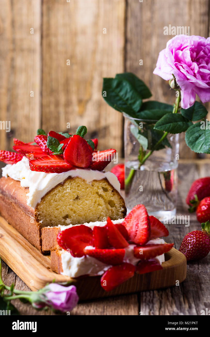 Strawberry cake, delicious holiday fruit dessert over light gray background - Stock Image