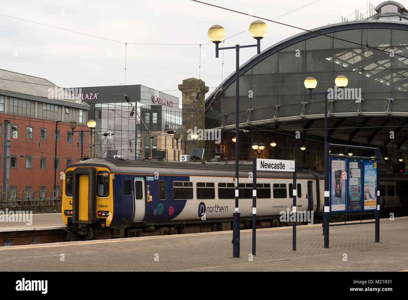 Northern Rail class 156 diesel multiple unit standing in Newcastle Central Station, north east England, UK - Stock Image
