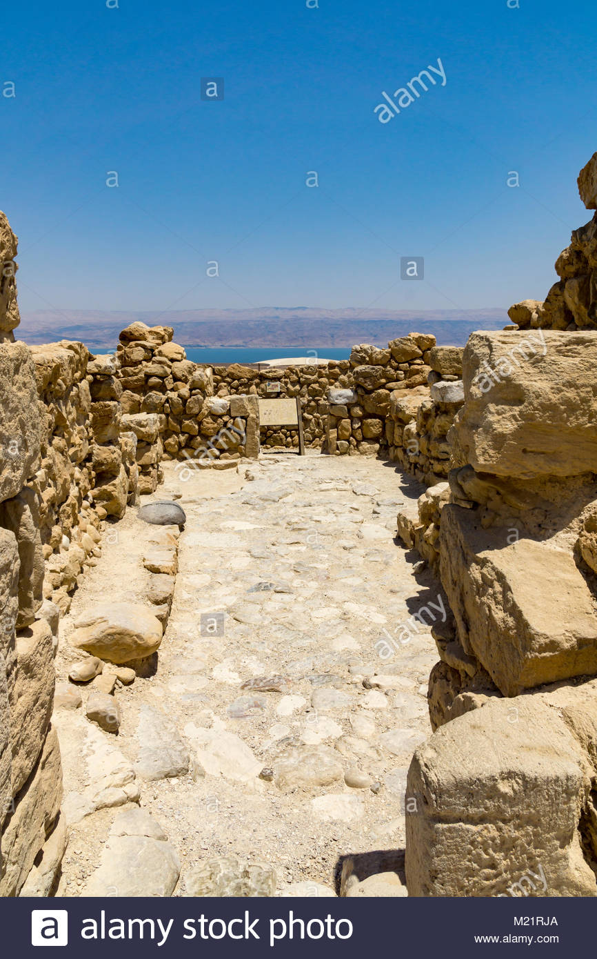 The Dead Sea lies just beyond the ruins of a settlement at Qumran National Park in Israel. - Stock Image