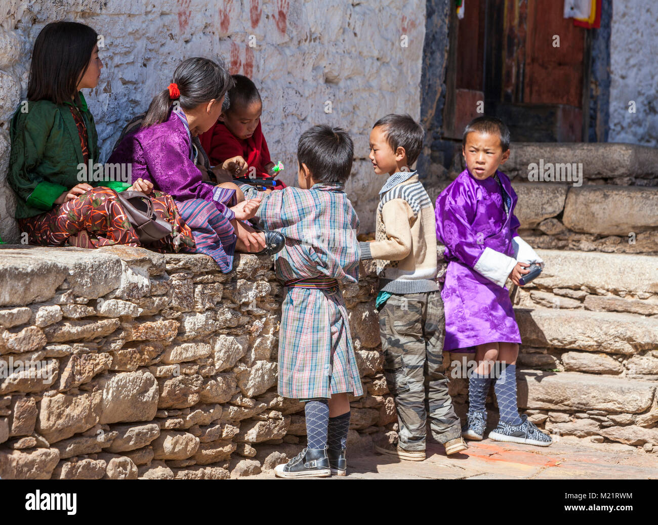 Prakhar Lhakhang, Bumthang, Bhutan.  Young Bhutanese Children, one in Western-style Clothes. - Stock Image
