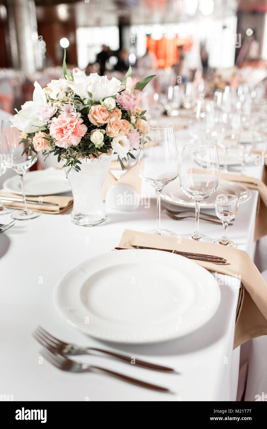 Tables set for an event party or wedding reception. luxury elegant table setting dinner in a restaurant. glasses and dishes. & Tables set for an event party or wedding reception. luxury elegant ...