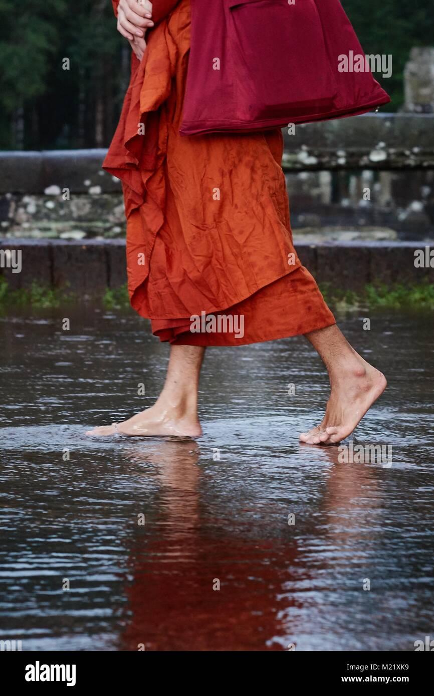 Buddhist monk walking on water, Angkor, Cambodia - Stock Image