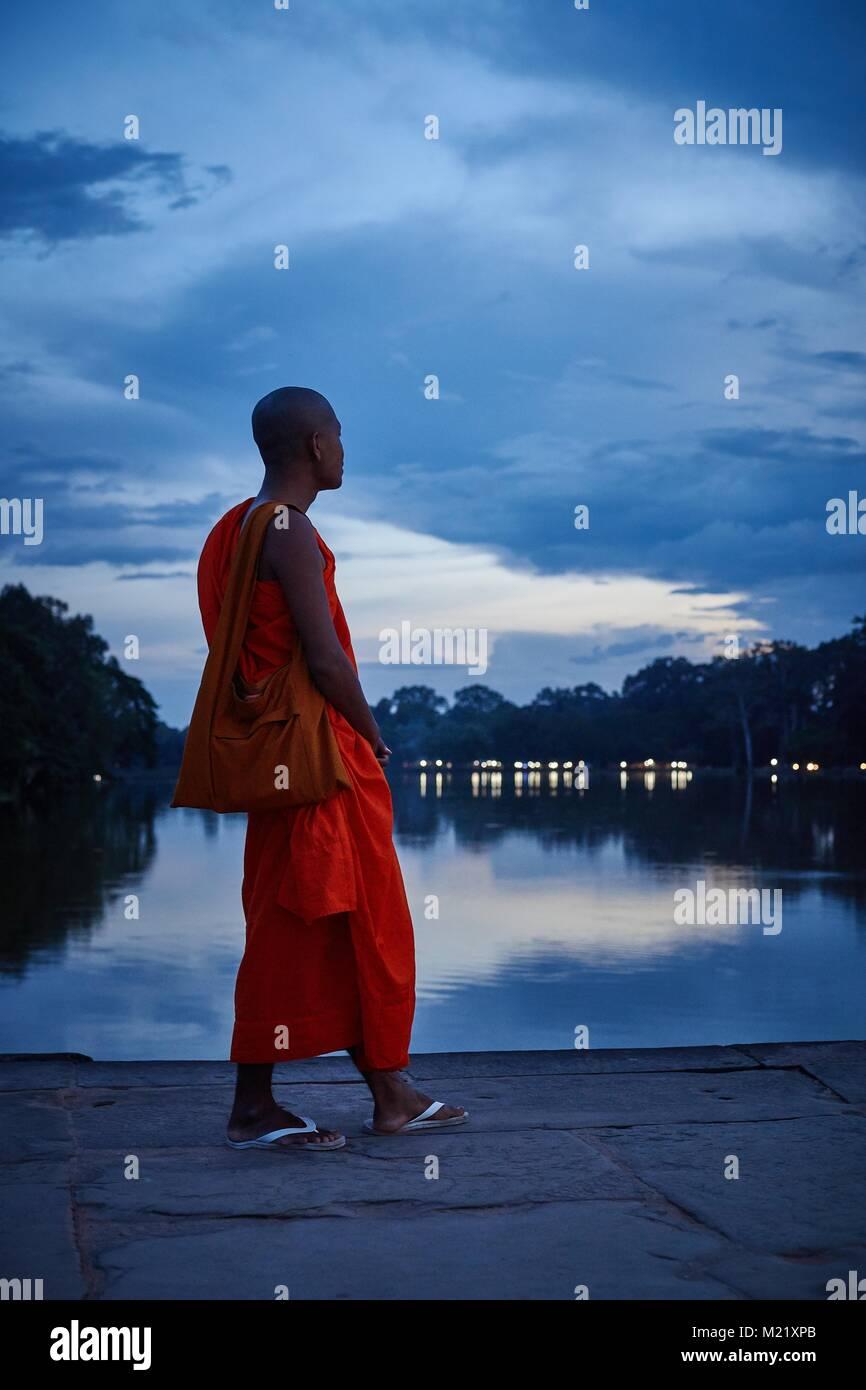Monk on a bridge, Angkor, Cambodia - Stock Image