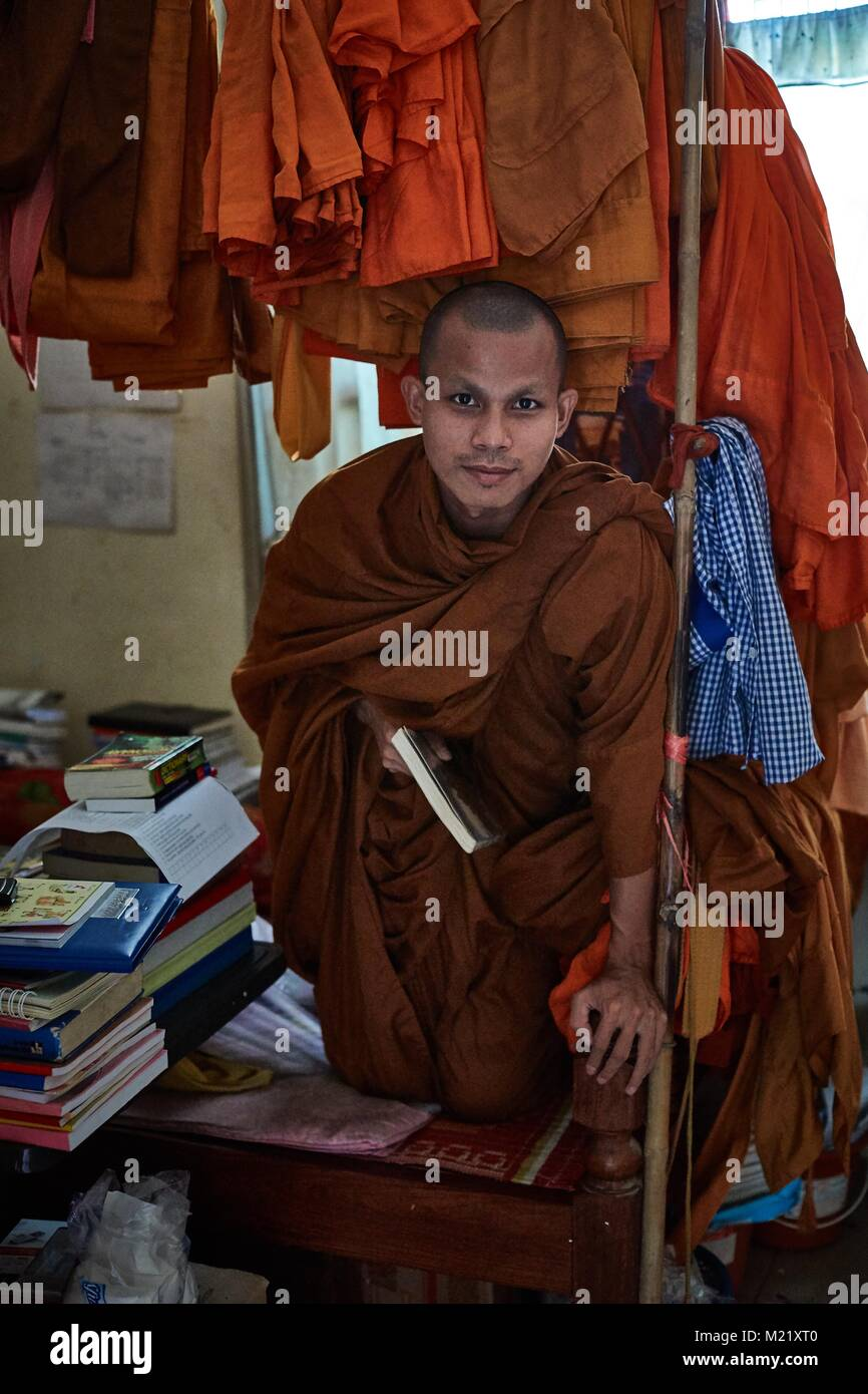 Buddhist Monk studying in monastry room, Battambang, Cambodia - Stock Image